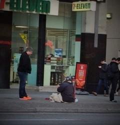 sitting on Robson Street